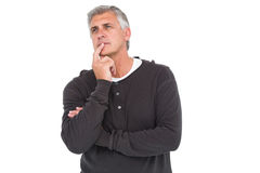 Casual man thinking with hand on chin Royalty Free Stock Photography