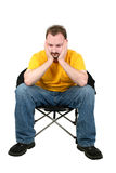 Casual Man Upset Sitting In Chair Over White Stock Image