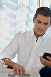 Casual Man Using Cell Phone Stock Photography