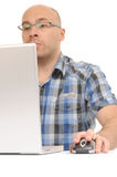 Casual man using computer with mouse Stock Photo