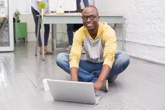 Casual man using laptop in office royalty free stock photos
