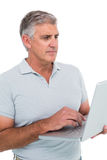 Casual man using a laptop Royalty Free Stock Photography