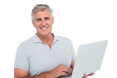 Casual man using a laptop Stock Photo