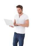 Casual man using laptop Royalty Free Stock Photography