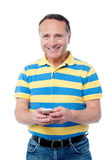 Casual man using  mobile phone Stock Image