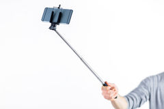 Casual man using a selfie stick Royalty Free Stock Photo