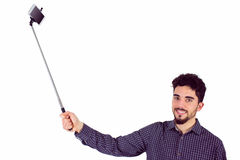 Casual man using a selfie stick Stock Photo