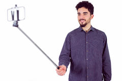 Casual man using a selfie stick Stock Images