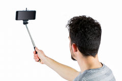 Casual man using a selfie stick Stock Photos