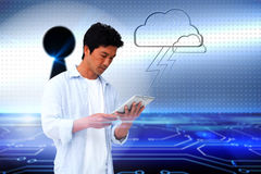 Casual man using tablet with cloud graphic Stock Photos
