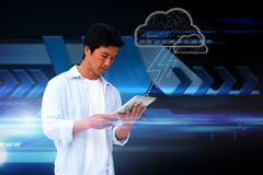 Casual man using tablet with cloud graphic Royalty Free Stock Photos