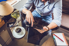Casual Man Using Tablet Computer Sitting in Cafe Surfing Internet Stock Photos