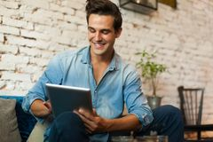 Casual Man Using Tablet Computer Smile Stock Photography