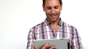Casual man using tablet pc. On white background in slow motion stock video footage
