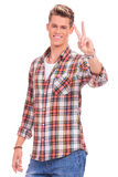 Casual man victory sign Royalty Free Stock Photo