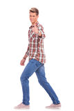 Casual man walking ok sign Royalty Free Stock Image