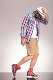 Casual man walking on studio background looking down Stock Photo