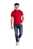 Casual man walking towards the camera. On white  background Royalty Free Stock Photo