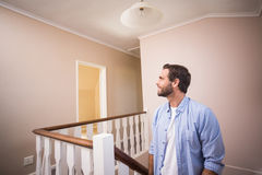 Casual man walking up the stairs. In his new home Stock Photo