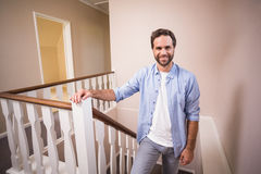 Casual man walking up the stairs Royalty Free Stock Photos