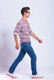 Casual man walks in front of you Royalty Free Stock Images