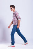 Casual man walks and looks away Royalty Free Stock Photography