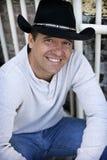Casual man wearing cowboy hat stock image