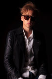 Casual man wearing a leather jacket and sunglasses. Stock Photo