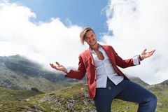 Casual man welcomes you to see the mountains Stock Images