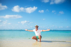 Casual man welcoming you to the beach of mauritius Stock Photography