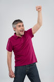 Casual man winning and celebrating over white background. Stock Photo