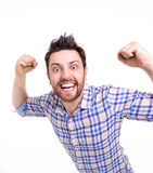 Casual man winning and celebrating on white background Royalty Free Stock Photos