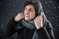 Casual man in winter cloth with snow Royalty Free Stock Image