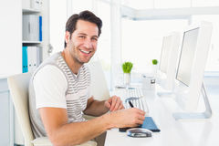 Casual man working at desk with computer and digitizer Stock Image