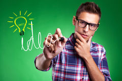 Casual man wrtiting Idea and light bulb Stock Photography