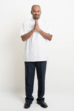 Casual mature Indian business people praying Royalty Free Stock Image