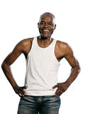 Casual mature man laughing with hands on waist. Portrait of a laughing afro American mature man with hands on waist standing in studio on white isolated royalty free stock image