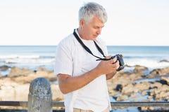 Casual mature man looking at his camera the sea Royalty Free Stock Image