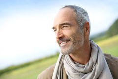 Casual mature man standing in countryside Royalty Free Stock Image