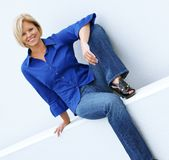 Casual Mature Woman. Beautiful mature women relaxing in casual clothes royalty free stock images