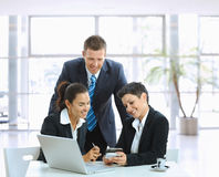 Casual meeting in office lobby Royalty Free Stock Images