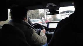 Casual men in car driving. Young men in casual winter outerwear sitting in car and driving while chatting stock video footage