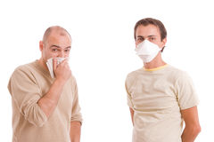 Casual men with flu. Isolated over white background Royalty Free Stock Images