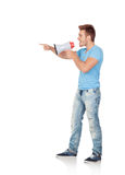 Casual men with a megaphone giving orders Stock Images