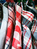Casual men`s shirts. Hanging on a rack Stock Images