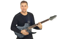 Casual mid adult man with guitar Stock Images