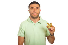 Casual mid adult man holding piggy bank Stock Photography