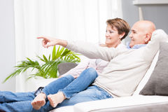 Casual middle-aged couple relaxing at home Stock Images