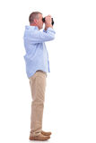 Casual middle aged man with binoculars Stock Photography