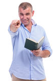 Casual middle aged man with book, pointing Stock Photography